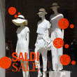 Boutique with mannequins in fashionable female white clothes — Stock Photo