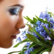 Beautiful teen girl smell and enjoy fragrance of snowdrop flower — Lizenzfreies Foto