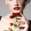 Beautiful woman with dark red roses flower in veil retro glamour — Stock Photo #33646617