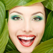 Woman beauty face with green leaves frame — Stock Photo