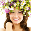 Young beautiful woman with garland of field fresh natural wild flowers — Stock Photo