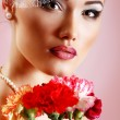Beautiful woman with pink flower retro glamour beauty portrait — Stok fotoğraf