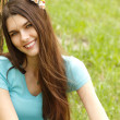 Portrait of charming young womanin spring forest — Stock Photo