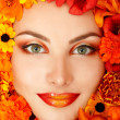 Beauty portrait of beautiful female face with orange flowers — Stock Photo