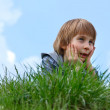 Happy little boy laying on green grass  — Stock Photo #33648021