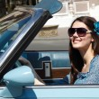 Young beautiful woman drive retro car in summer city — Stock Photo