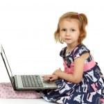 Adorable little girl using laptop — Stock Photo
