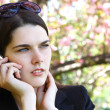 Beautiful troubled girl calling phone outdoor — Stock Photo #33648199