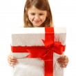 Happy little girl open box with christmas present — Stok fotoğraf