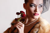 Beautiful woman with dark red roses — Foto Stock