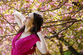 Spring portrait of teen girl over nature garden Japanese cherry — Stock Photo