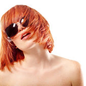 Portrait of young beautiful redheaded girl in sunglasses — Stock Photo