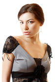Beautiful face of young woman in dress — Stock Photo