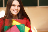 Beautiful teen girl high achiever in classroom happy smiling — Stok fotoğraf