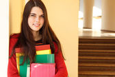 Beautiful teen girl in university happy smiling — Stock Photo