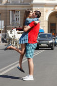Love story of young couple hug and kiss in summer city — Stock Photo