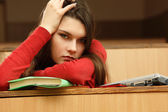 Student teen girl beautifyl tired in empty classroom university — Stock Photo