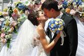 Wedding ceremony - groom kiss bride — Stock Photo