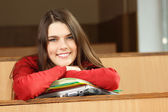 Beautiful teen girl high achiever in classroom — Stockfoto