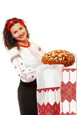 Beautiful ukrainian young hospitable woman in native costume — Stock Photo