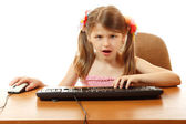 Child with internet dependence with keyboard looking at camera like in monitor — Stock Photo