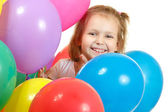 Happy little girl with color balloon isolated on white — Stock Photo
