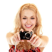 Happy young woman photographer doing photos with still camera — Stock Photo