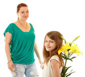 Little daughter send greetings and flowers to her mother — Stock Photo
