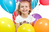 Portrait of little girl with color balloon isolated on white — Stock Photo