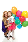 Mother with liitle daughter with multicolor balloons — Stock Photo