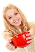 Attractive smiling girl offer big red cup — Stock Photo