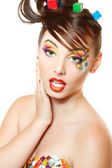 Young attractive woman with beautiful art cube abstract make-up — Stock Photo