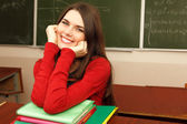 Beautiful teen girl high achiever in classroom near desk happy smiling — Foto de Stock