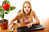 Teen girl with internet dependence looking in monitor — Stock Photo