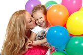 Mother kiss her little happy daughter — Stock Photo