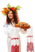 Beautiful ukrainian woman in garland and native costume — Stock Photo