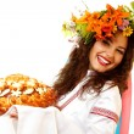 Ukrainian young woman in native costume — Photo