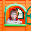 Little boy playing in toy house — Stock Photo