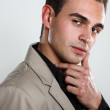 Man in black shirt and beige jacket — Stock Photo #38399155