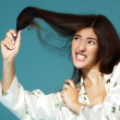 Teen girl try to bomb her hair — Stock Photo