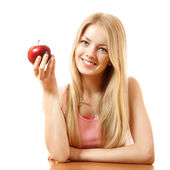 Happy teeny girl with red apple — Stok fotoğraf