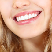 Beautiful smile of young woman — Stock Photo