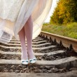 Bride's walks on the railway — Stock Photo