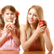 Teeny girl with red apple and little girl with cake — Stok Fotoğraf #38400411