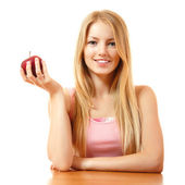 Teeny girl with red apple — Stockfoto