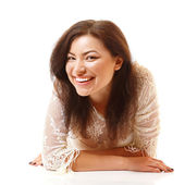 Young woman lying down and smiling — Stock Photo