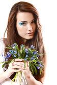 Teen girl smell fragrance of flowers — Stok fotoğraf