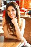 Cheerful girl with long brown hair — Stok fotoğraf
