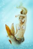 Beautiful mermaid girl with fish tail — Stock Photo