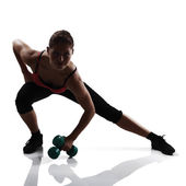 Girl doing exercise with dumbbells — Stock Photo